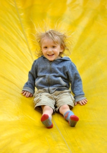 There's nothing like a bouncy slide to put a smile on a small boy's face.