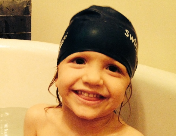 Trialling the swim hat, as a bath is much more fun.